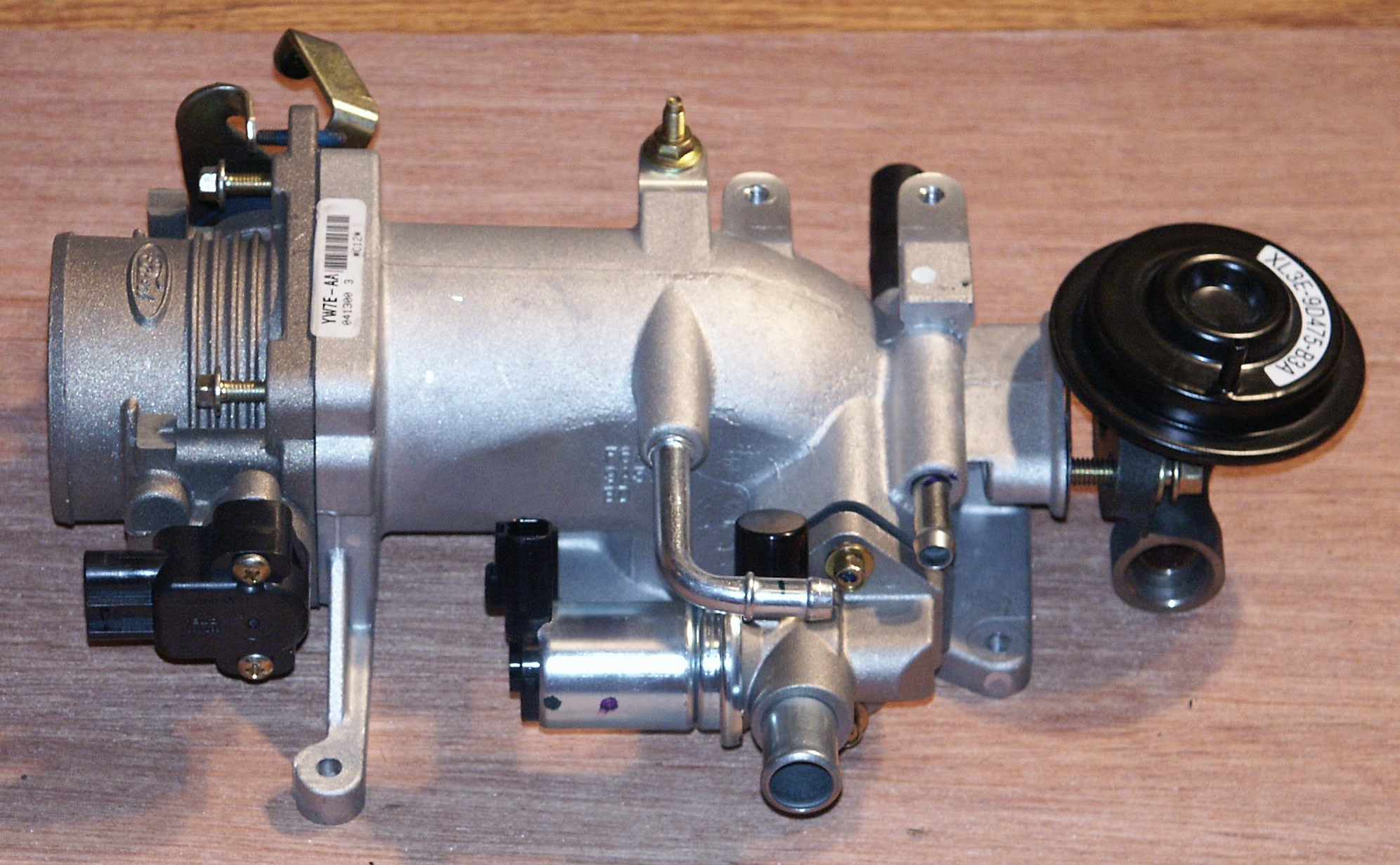 Below are some pictures of an air intake plenum assembly and some supporting components from a 2000 ford crown victoria