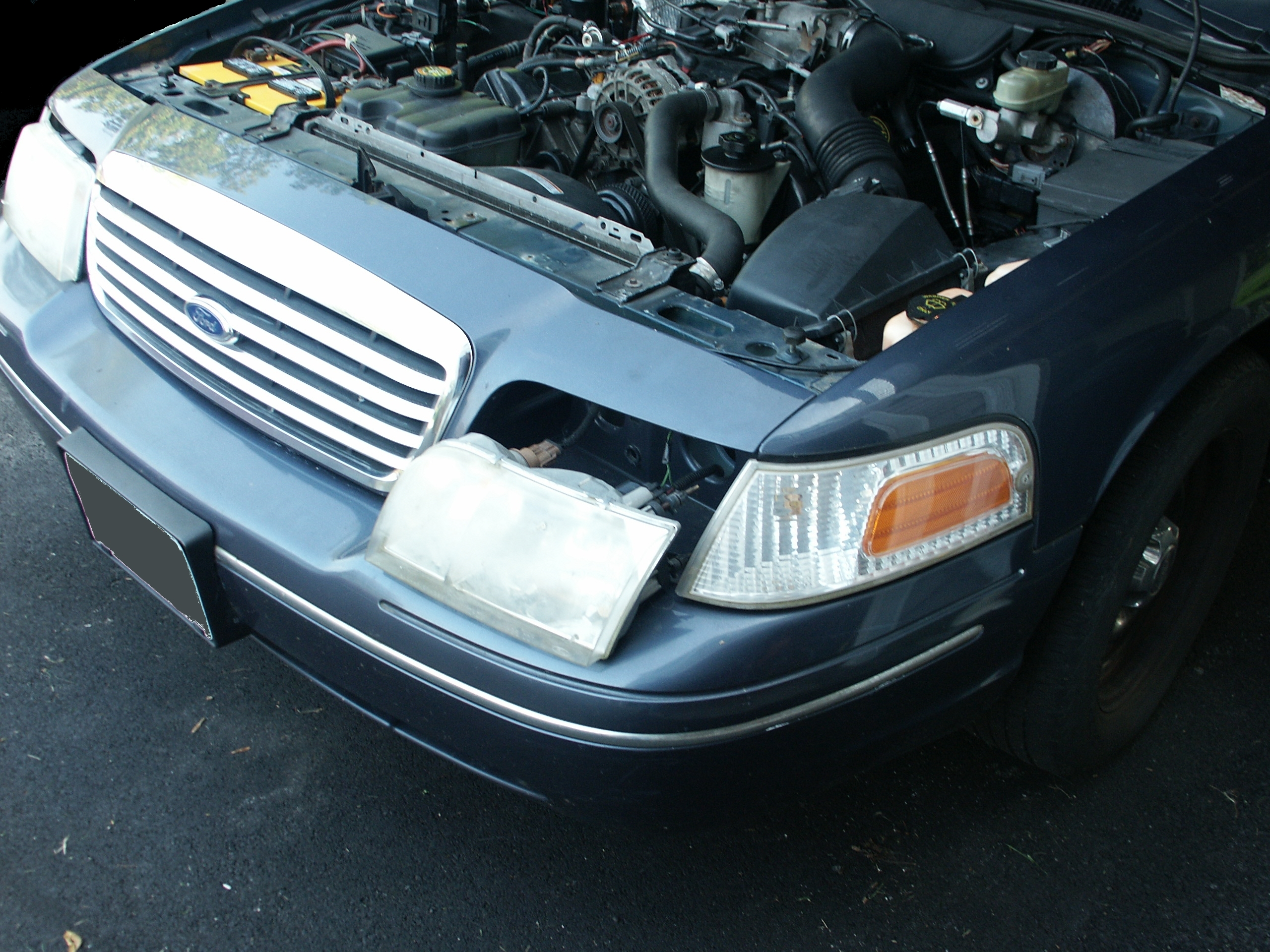 The headlights slide forward easily once the retainers have been removed
