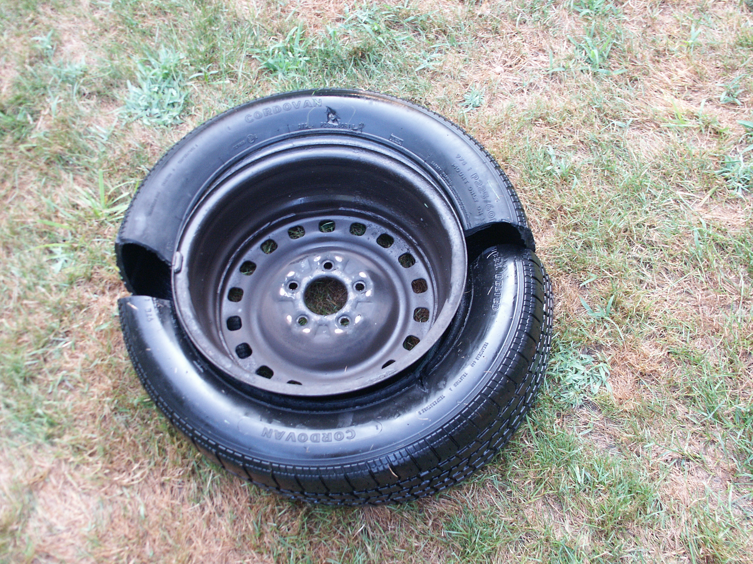 cutting apart a steel belted radial car tire